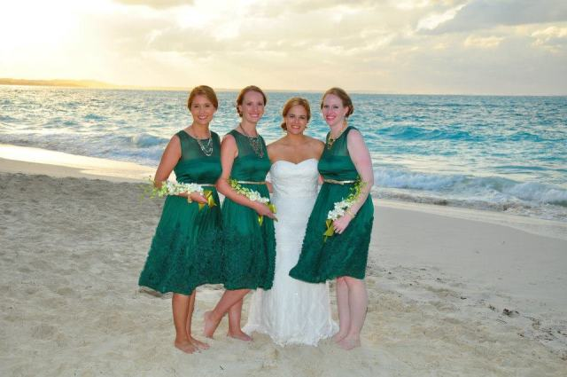 The four of us at Samantha and Michael's wedding last March!  This will be our first full reunion since then!